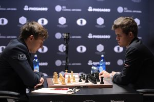 NEW YORK, NY - NOVEMBER 12: Reigning Chess Champion Magnus Carlsen and Chess grandmaster Sergey Karjakin during the game at 2016 World Chess Championship at Fulton Market Building on November 12, 2016 in New York City. (Photo by Jason Kempin/Getty Images for Agon Limited)